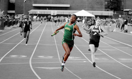 McGann-Mercy senior Danisha Carter crosses the finish line first in the 4 x 100 heat at Friday's state championship. (Credit: Hal Henty)
