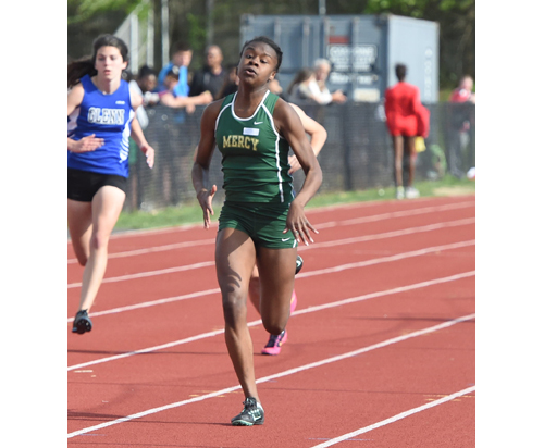 McGann-Mercy senior Danisha Carter, shown here Monday in the preliminaries, ran a personal best time in the 200-dash Wednesday at the Division III Championships. (Credit: Robert O'Rourk)