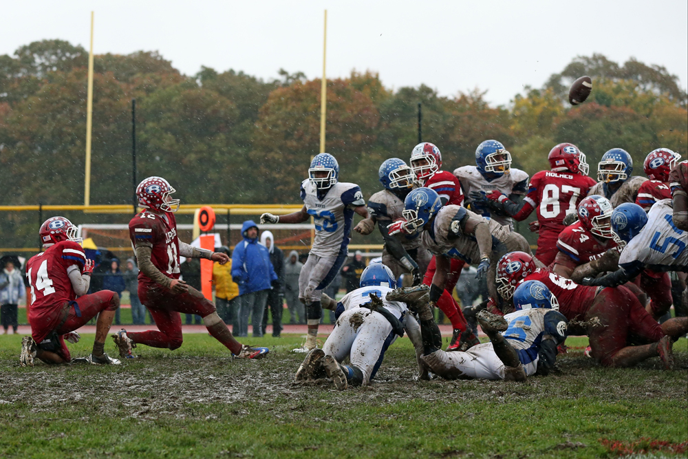 Bellport's Nick Founts has his last-second field goal attempt blocked by Troy Trent (77). (Credit: Daniel De Mato)