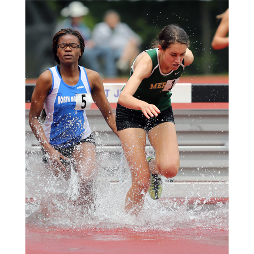 Delina Auciello of McGann-Mercy competes in the steeplechase. (Credit: Daniel De Mato)