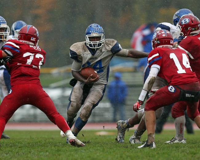 Riverhead's Raheem Brown rushes up the middle for a first down. (Credit: Daniel De Mato)