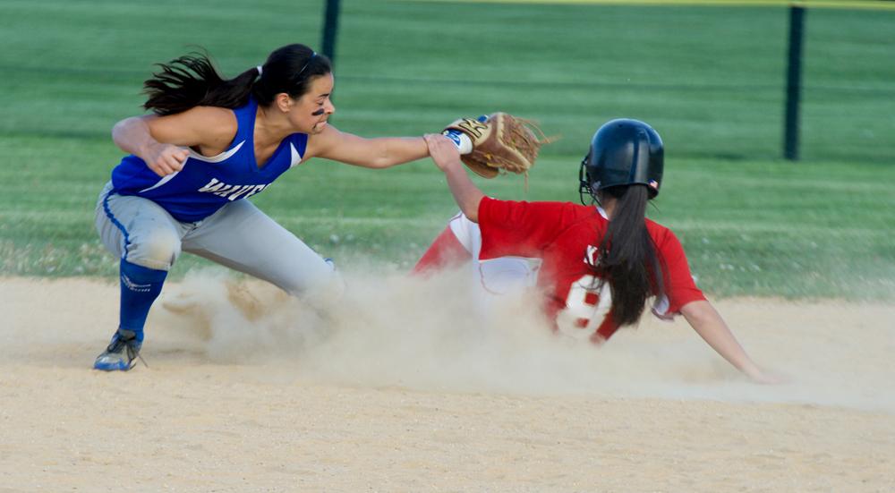 Riverhead shortstop Dani Napoli applies a tag on Hills West senior Samantha Katz. (Credit: Robert O'Rourk)