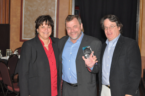 GRANT PARPAN PHOTO | Denise Civiletti and Peter Blasl of Riverhead Local with  award presenter Tom Lennon.
