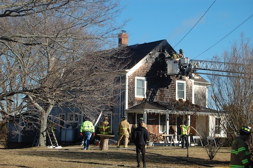 Firefighters inspect the damage to the home. (Credit: Cyndi Murray)