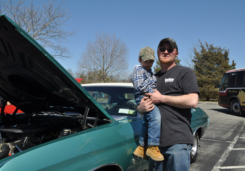 Tobie Wesnofske of Cutchogue with Nathan Ovsianik in front of a 1970 Chevy first owned by his father. (Credit: Vera Chinese)