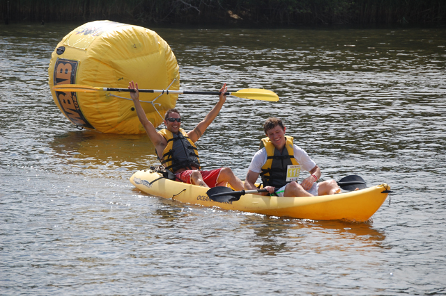 Two racers celebrate at the Paddle Battle Saturday afternoon. (Credit: Vera Chinese)