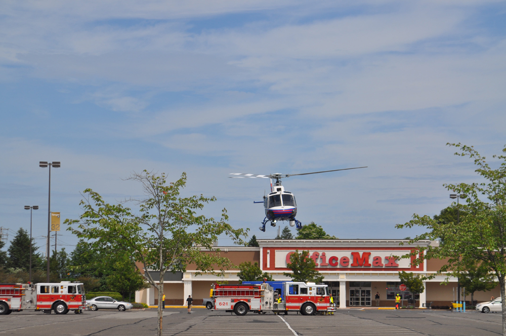 A police helicopter lands in front of Office Max on Route 58. (Credit: Joe Werkmeister)