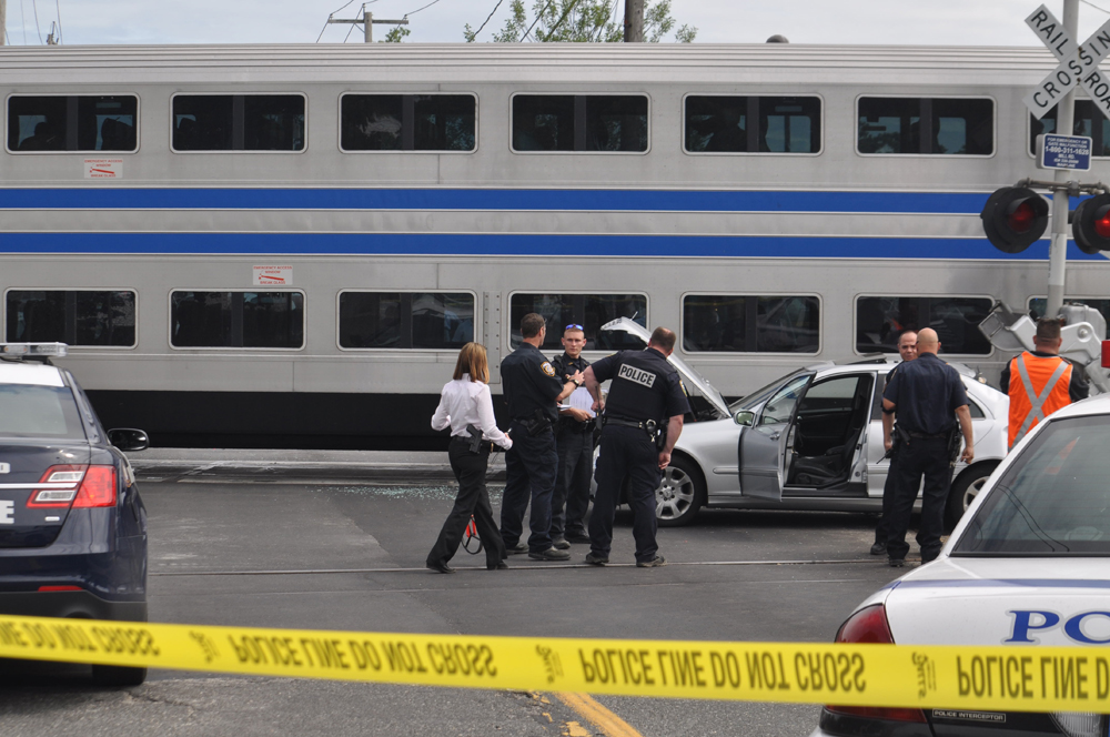 Investigators on the scene of Thursday's train crash in Riverhead. (Credit: Joe Werkmeister)