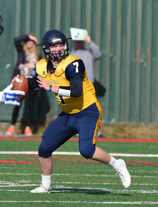 Shoreham-Wading River quarterback Kevin Cutinella throws a pass early in Saturday's semifinal win.