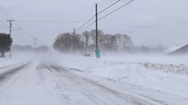 Drifts have caused poor visibility along stretches of Main Road and Sound Avenue Sunday as well as other open-space areas. (Credit: Vera Chinese)