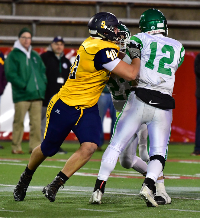 Ethan Wiederkehr chases after the Seaford quarterback. (Credit: Robert O'Rourk)