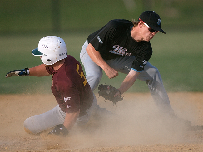 Dan Popio of Riverhead, who tied for second in the HCBL with five home runs, sliding into second base while Sag Harbor second baseman Ted Shaw covers the bag. (Credit: Garret Meade)