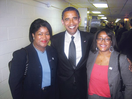 DANIELLE GRAY COURTES PHOTO |  Danielle Gray (right) poses with Barack Obama and her mother, Denise, in Chicago in October. Ms. Gray, a 1996 Riverhead High School graduate, was deputy policy director of the first Obama campaign.