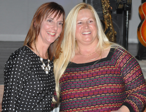 GRANT PARPAN PHOTO | Denise Lucas of Move the Animal Shelter, right, with award presenter Angie Reese.