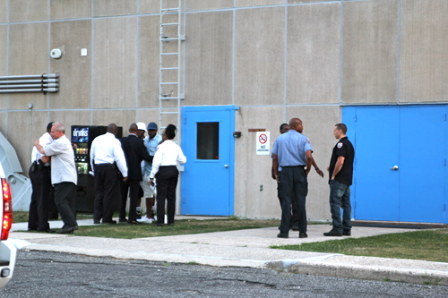 A group of New York City corrections officers at the scene. (Credit: Jennifer Gustavson)