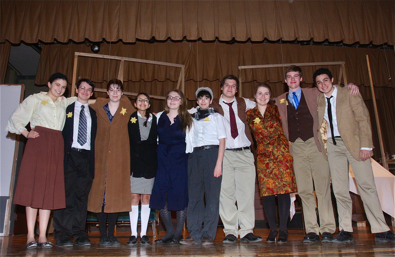 "McGann-Mercy Theatre Company cast of ""Diary of Anne Frank"": (From left) Olivia Geppel of Mattituck as Anne Frank; Max Crean of Farmingdale as Otto Frank; Caitlin Jacobs of Mattituck as Edith Frank; Andrea Londono of Hampton Bays as Margot Frank; Kelsey Tuthill of Manorville as Miep Gies; Jason Crean of Farmingville as Peter Van Daan; Corey Hermus of Bellport as Mr. Kraler; Grace Lukachinski of South Jamesport as Mrs. Van Daan; Chris Ryder of Moriches as Mr. Van Daan and John Tumminello as Mr. Dussel. (Credit: Barbaraellen Koch)"