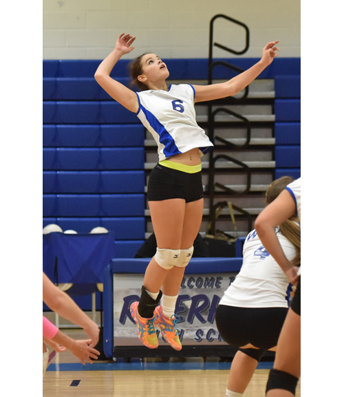 Riverhead senior Rachel Doroski rises up for a hit in Friday's match against Smithtown West. (Credit: Robert O'Rourk)