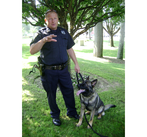 TIM GANNON FILE PHOTO | Riverhead Town Police Officer John Doscinski and his partner, Vaki.