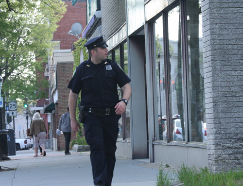 A Riverhead police officer walks the beat downtown on Monday night. (Credit: Barbaraellen Koch)