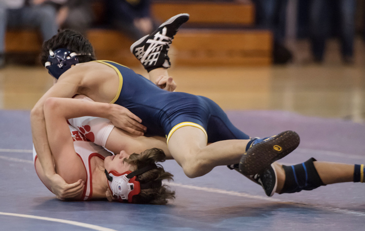 Dylan Meloni pins his opponent. (Credit: Robert O'Rourk)