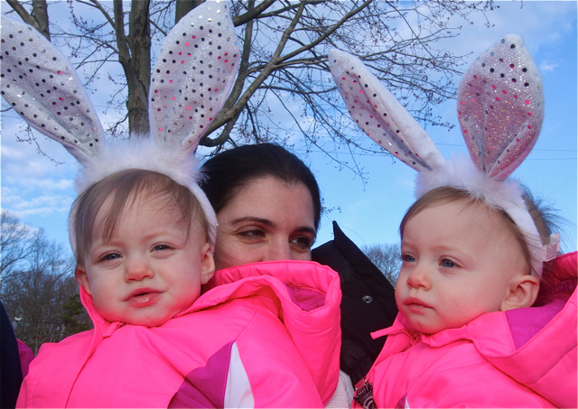 Donna Amoscato of Shirley, formerly of Riverhead, with her twins Mia (left) and Alanna, 1, wait for the first egg hunt to start. (Credit: Barbaraellen Koch)