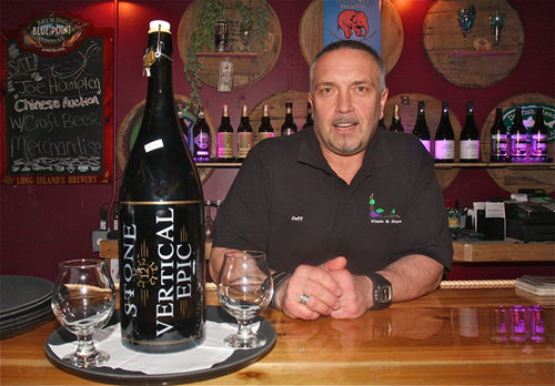 Jeff McKay, co-owner of Vines & Hops Café in Riverhead, with the store's remaining bottle of the 2012 Vertical Epic brew, currently on sale for $200. (Credit: Barbaraellen Koch)