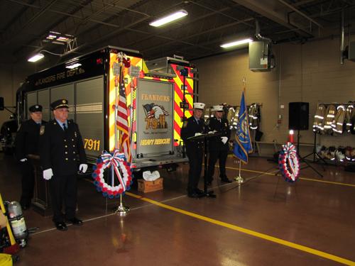 Chaplain Bob Bourguignon leads the annual Flanders Fire Department memorial service Sunday. Tim Gannon photo