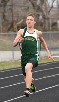 McGann-Mercy senior Alex Fabrizio carries the baton to finish the 4 x 100 relay. (Credit: Robert O'Rourk)