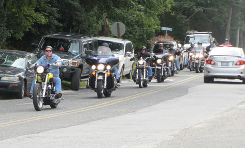 TIM GANNON PHOTO | Bikers arrive at The Maples in Manorville, the second stop of a charity poker run to defray medical costs of Tom Jasinski, a longtime Riverhead Firefighter who recently died.