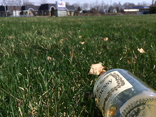 A leftover bottle of Hennessy lies on the ground outside Cinco De Mayo Sunday morning after a fight broke out involving nearly 100 people. (Credit: Grant Parpan)