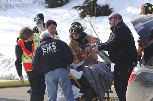 Rescue workers aid one of the victims in the explosion in Water Mill yesterday. (Credit: The Southampton Press/Dana Shaw)