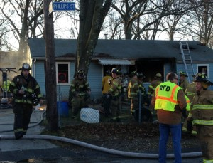 PAUL SQUIRE PHOTO   Volunteer firefighters knocked down a house fire in a ranch-style house Wednesday morning in Riverhead.