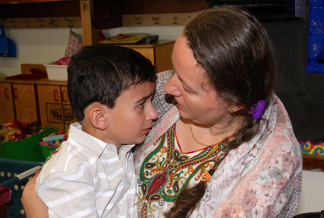 Elizabeth Przyborowska comforts her son Ibrahaim, 5, in his kindergarten classroom.