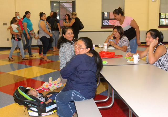 "After dropping off their children, parents gathered in the new cafeteria for what the school calls the ""Boo-Hoo"" breakfast."