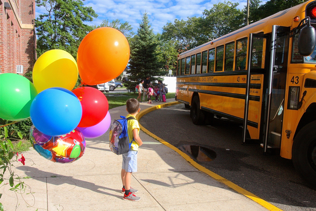 Kindergartner Edward Stackevicius waits for other students to get off the bus.
