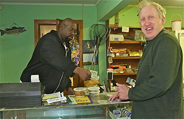 Fishermans Deli worker Roger Miles sells some bait to longtime customer Mike O'Donnell of Calverton Thursday morning. (Credit: Barbaraellen Koch)