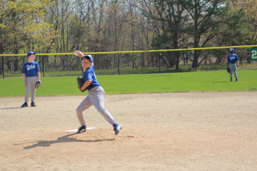 JENNIFER GUSTAVSON FILE PHOTO | The Flanders Little League Opening day has been postponed. Here's Fisher Landscaping pitcher Chris, 11, warming up at last year's event.