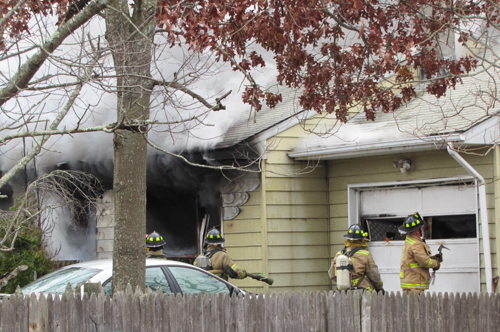 TIM GANNON PHOTO | Firefighters at the scene of Monday's house fire on Priscilla Avenue in Flanders.