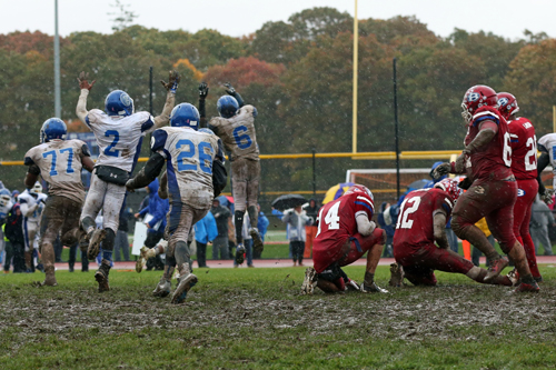 Riverhead celebrates after Bellport's Nick Founts (#12) has his last second field goal attempt blocked by Troy Trent (#77.) (Credit: Daniel DeMato)