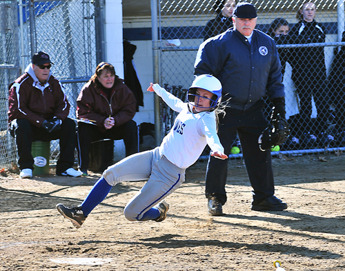 Riverhead's Sarah Freeborn slides into home plate to score a run against Kings Park. (Credit: Robert O'Rourk)