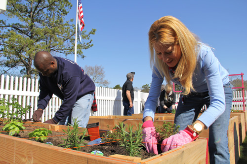 Southampton Councilwoman Christine Scalera planting herbs Saturday morning.
