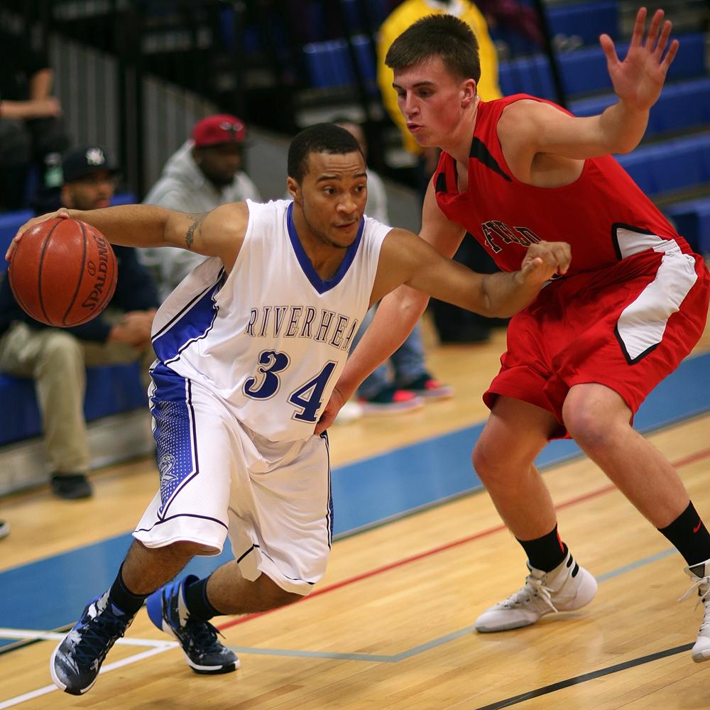 Malik Washington tries to get past a Newfield defender. (Credit: Garret Meade)
