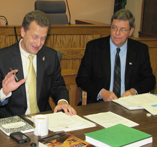 TIM GANNON FILE PHOTO | Supevisor Sean Walter (left) and Councilman George Gabrielsen during a recent Town Board meeting.