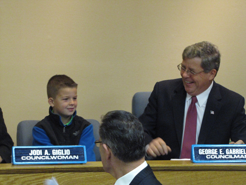 Councilman George Gabrielsen was joined by grandson Robert, 9, at his last meeting Thursday. (That's Town Attorney Bob Kozakieiwicz in front, no doubt giving Robert some legal advice)