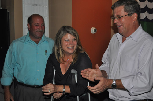 GRANT PARPAN PHOTO | Councilwoman Jodi Giglio celebrates her primary election win with fellow Town Board members James Wooten (left) and George Gabrielsen.