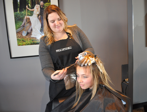 Stylist Ashley Fogerty gives Grace Kaelin of Aquebogue highlights Saturday afternoon at Gabriel Loren the Salon in Riverhead. (Credit: Rachel Young)