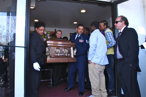 BARBARAELLEN KOCH PHOTO  |  Pallbearers carrying the casket out of the Galilee Church of God in Christ Saturday.