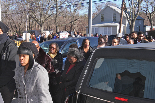 BARBARAELLEN KOCH PHOTO     A long line of mourners arrived early Saturday at Galiee First Church of God in Christ.