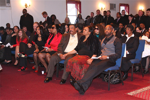 BARBARAELLEN KOCH PHOTO  |  Demitri Hampton's family in the front row: (from right) brother Jamal Davis, parents Juanita and Theodore 'Teddy' Trent, and sister Jennifer Davis.