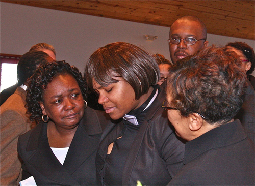 BARBARAELLEN KOCH PHOTO  |  Demitri Hampton's cousin Latisha Diego (center) is helped by other mourners as she goes up to view the casket for the final time before it is closed.